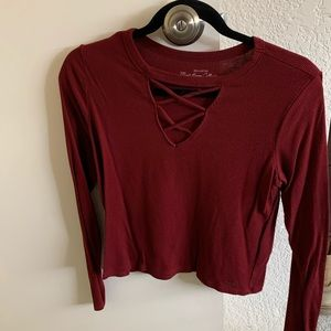 Long sleeve shirt with detailed neckline